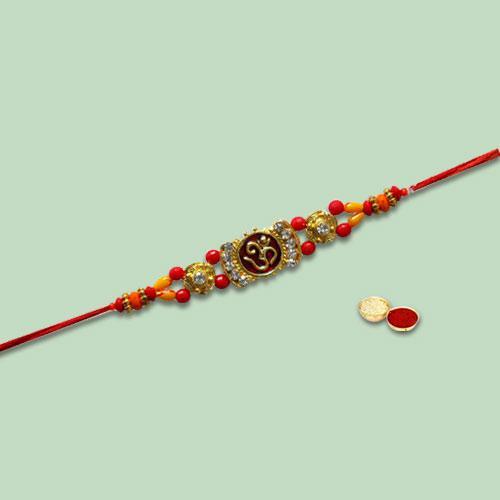 Elegant Present of Om Rakhi with Free Roli Tika Chawal