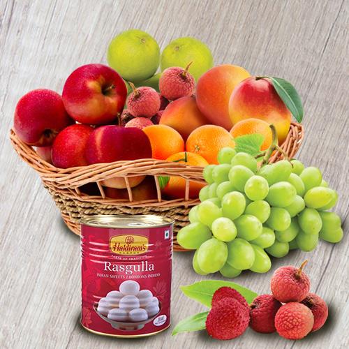 Scrumptious Fresh Fruits Basket with Haldiram Rasgulla