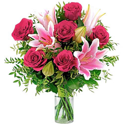 Aromatic Assemble of Pink Lilies with Red Roses in Glass Vase