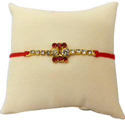 Amazing Gold Plated Rakhi Studded With Stones