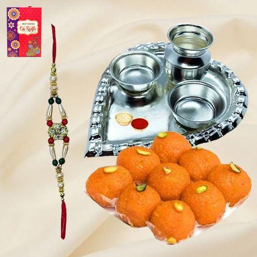 Trendy Rakhi and Silver Plated Paan Shaped Puja Thali