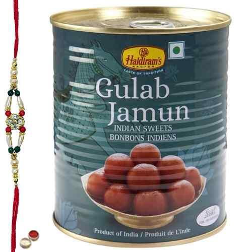 Relishing <font color=#FF0000>Haldiram</font> Gulab Jamun with Free Rakhi, Roli Tilak and Chawal
