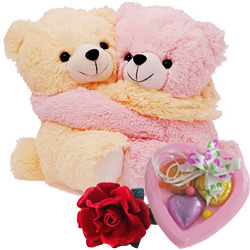 Cute Hugging Couple Teddy with 1 Velvet Rose and 3 pcs Heart Homemade Chocolate