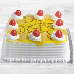 Eggless Pineapple Cake (1Kg) to Navrangpura H O