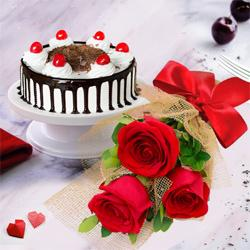 Stunning 3 Red Roses with 1/2 Kg Black Forest Cake to Revdi Bazar H O