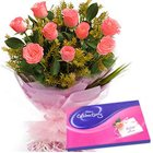 Gaudy Pink Roses Hand Bunch with Cadbury Assortment to Janta Nagar