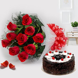 Exquisite 12 Red Roses with 1/2 Kg Black Forest Cake to Rakhial R S