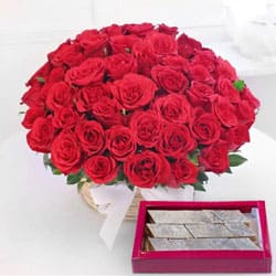 Astounding Red Roses with yummy Kaju Barfi to Godhavi