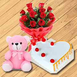 Heavenly 12 Dutch Red Roses with Teddy Bear and 1/2 Kg Heart Shaped Cake