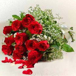 Luminous Bouquet of 12 Red Roses for Sweet Surprise to Dhandhuka
