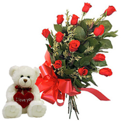 12 Red Roses Bunch with a small teddy bear to Sant Punit Marg