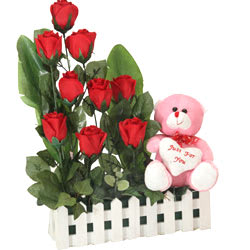 Breathtaking Nine Red Roses with a Teddy with Heart with Loving Embraces