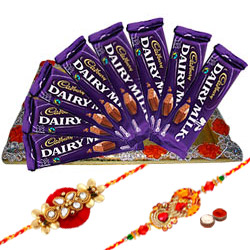 Zesty Selection of 8Pcs Cadbury Dairy Milk Chocolates with 2 Designer Rakhi and Roli Tilak Chawal