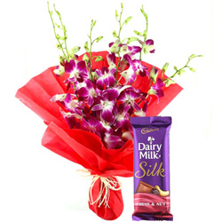 Send Bouquet of Orchids N Dairy Milk Silk Online