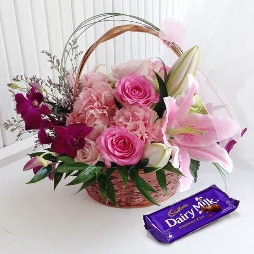 Appealing Box of Cadburys Chocolate with Flower Arrangement