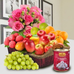 Fresh Fruits in a Basket with Haldiram Rasgulla and Pink Rose Bouquet for Mom