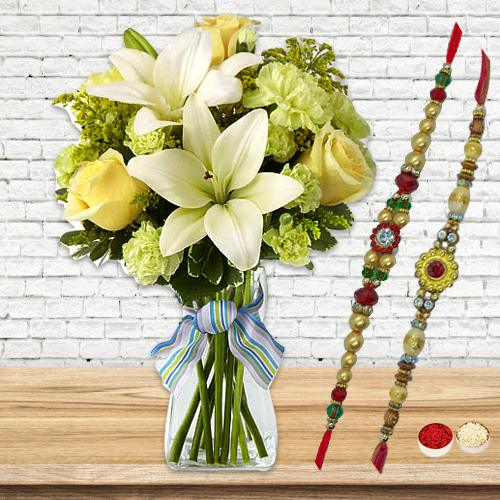 Mellowing Bouquet of Flourishing Flowers with Free 2 Rakhis and Roli Tilak Chawal