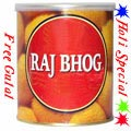 Nicely Gift Wrapped Raj Bhog 1 Kg from Haldiram with free Gulal/Abir Pouch.