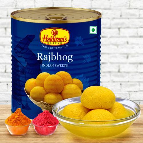 Nicely Gift Wrapped Raj Bhog 1 Kg from Haldiram with free Gulal/Abir Pouch.